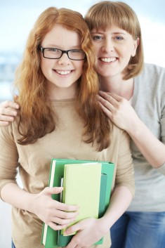 Lovely girl and her mother smiling